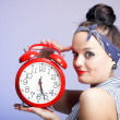 Stock Photo: Womwith red clock. Time management concept.