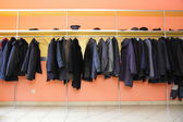 Many clothes in cloakroom — Stock Photo
