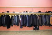 Many clothes in cloakroom — Stockfoto