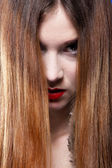 Woman shiny straight long hair and make-up — Stock Photo