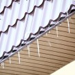 Stock Photo: Icicles on a roof