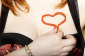 Female hand with heart love symbol on chest — Stock Photo