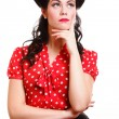 Beautiful young pinup girl thinking, isolated — Stock Photo