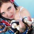 Summer girl plenty of jewellery beads in hands - Stok fotoğraf