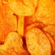 Close up potato paprika chips as background - Stock Photo