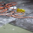 Stock Photo: Coils of electrical cable lying on floor workplace