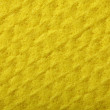 Yellow sponge foam as background texture — Stock Photo #24414065