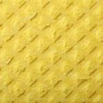 Yellow sponge foam as background texture — Stock Photo #24414207