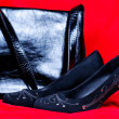 Black woman and handbag shoe on red background — Stock Photo