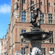 Neptune Fountain and city hall in Gdansk, Poland - Foto Stock