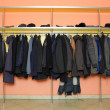 Many clothes in cloakroom — Stock Photo #24414593