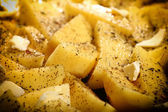 Raw potatoes with spices ready to be roasted — Stock Photo