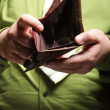 Stock Photo: Empty wallet in male hands - poor economy