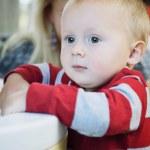 Portrait of little pensive baby boy indoor — Stock Photo