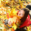 Autumn woman on leafs background — Stock Photo