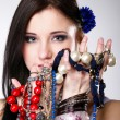 Summer girl plenty of jewellery beads in hands — Stock Photo #24562733