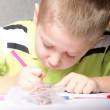 Young cute boy draws with color pencils — Stock Photo #24564109