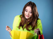 Surprised girl with paper shopping bag. Sales. — Stock Photo