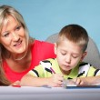 Mother and son drawing together — Stock Photo #24631415