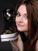 Girl with casual shoe. Women loves shoes concept. — Stock Photo