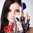 Summer girl plenty of jewellery beads in hands — Stock Photo #24756657