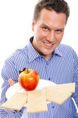 Healthy lifestyle man eating crispbread and apple — Stock Photo