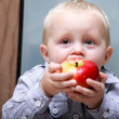Little boy eating apple — Stock Photo