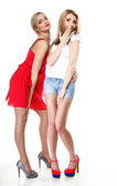 Two beautiful sexy women in summer clothes. — Stock Photo