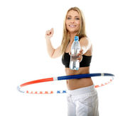Young fitness woman with hula hoop isolated — Stock Photo