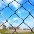 Metal mesh with blur basketball court background - Stock Photo