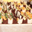 Varieties of cakes desserts catering sweets - Stock Photo