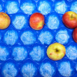 Apple fruits in blue box for sale, market — Stock Photo