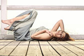 Young woman is relaxing on the pier — Stock Photo
