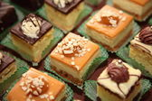 Varieties of cakes desserts catering sweets — Stock Photo