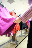 Shopping woman choose blouse at clothing shop — Stok fotoğraf