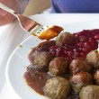 Food being eaten. Dinner meatballs with potatoes. — Stock Photo #25501593
