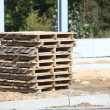Stack of wooden pallets. Make a pathway — Stock Photo