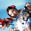Stock Photo: Summer girl plenty of jewellery beads in hands