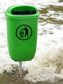 Green pastic garbage bin or can on street — Stock Photo