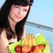Woman long hair holding basket fruits summer — Stock Photo