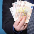 Euro banknotes in male hand — Stock Photo