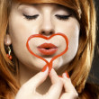 happy redhair girl with heart love symbol — Stock Photo