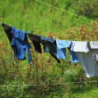 Clothes hanging to dry on a laundry line — 图库照片