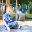 Child boy or kid playing on playground — Stock Photo #26740369