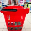 Shopping basket with grocery at supermarket — Stok fotoğraf