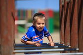 Child in playground, kid in action playing — Стоковое фото