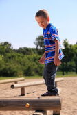 Child in playground, kid in action playing — Foto Stock