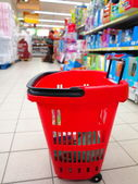 Shopping basket with grocery at supermarket — Stock Photo