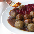 Food being eaten. Dinner meatballs with potatoes. — Stock Photo