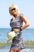 Mature woman on beach summer holiday — Stock Photo